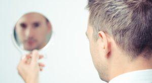 Trader mit Spiegel